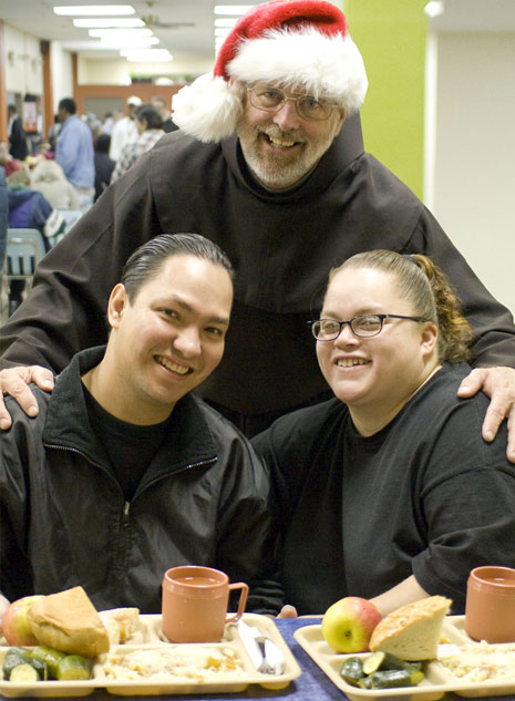 Fr. John with guests at St. Anthony's Dining Room